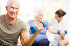 Physiotherapist helping patients with exercises Stock Photo
