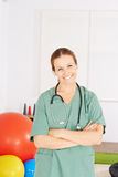 Physiotherapist with her arms crossed Royalty Free Stock Images