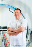 Physiotherapist in his clinic Stock Photos