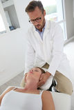 Physiotherapist making massage to a woman patient Stock Images
