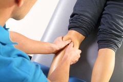 Physiotherapist massaged patient's leg. Physiotherapy. massage. Masseur massaged his calf Stock Photography