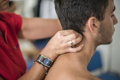 Cervical pain cured by physiotherapist stock images