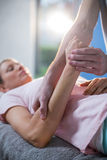 Physiotherapist massaging hand of a female patient Royalty Free Stock Photo