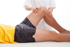 Physiotherapist massaging a leg Stock Images