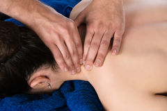 Physiotherapist massaging patient Royalty Free Stock Photography