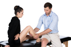 Physiotherapist massaging patient Royalty Free Stock Photos