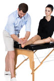 Physiotherapist massaging patient Stock Photos