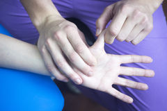 Physiotherapist massaging patient mobility injury Royalty Free Stock Photo