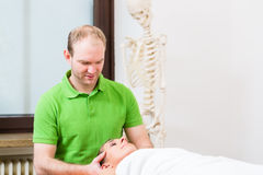 Physiotherapist massaging womans face Stock Images
