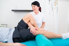 Physiotherapist medicate patient in practice Stock Image