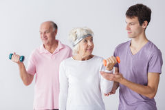 Physiotherapist and older couple Stock Photo