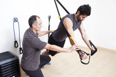 Physiotherapist with patient. Physiotherapist helping patient showing him the exercise Royalty Free Stock Images