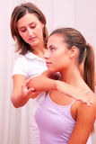 Physiotherapist shoulder assessment Stock Image