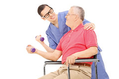 Physiotherapist showing an exercise to mature man Stock Photography