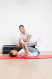 Physiotherapist showing woman an exercise Stock Images