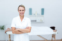 Physiotherapist smiling at camera arms crossed Stock Image