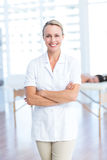 Physiotherapist smiling at camera arms crossed Royalty Free Stock Image