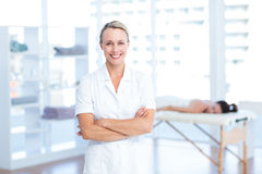 Physiotherapist smiling at camera arms crossed Royalty Free Stock Photography
