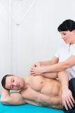 Physiotherapist or sport doctor patient in practice Royalty Free Stock Image