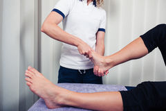 Physiotherapist treating foot Royalty Free Stock Image