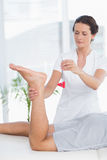 Physiotherapist using reflex hammer Royalty Free Stock Images