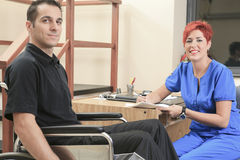 Physiotherapist woman help client at job Stock Photography