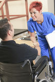 Physiotherapist woman help client at job Royalty Free Stock Image