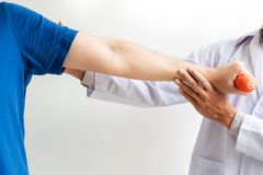Physiotherapist working concept, Doctor and patient suffering or Chiropractor examining from shoulder pain in clinic medical. Office royalty free stock images