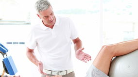 Physiotherapist working with his patient