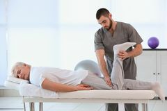 Physiotherapist working with patient. In clinic Royalty Free Stock Image
