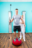 Physiotherapist working with patient in practice Stock Photos