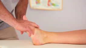 Physiotherapist working on a patients foot