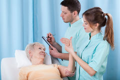 Physiotherapists diagnosing patient Stock Photos