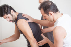 Physiotherapists with Patient Stock Images