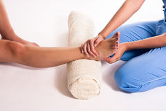 Physiotherapy. Young physiotherapist doing therapy to a women Stock Photos