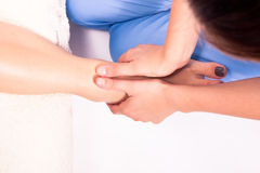 Physiotherapy. Young physiotherapist doing therapy to a women Royalty Free Stock Image