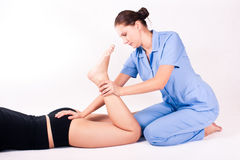 Physiotherapy. Young physiotherapist doing therapy to a women Stock Photo