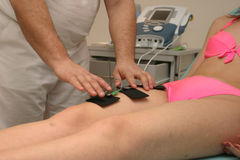 Physiotherapy. Medical procedure Stock Photos