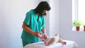 Physiotherapy for baby boy to feet Stock Photography