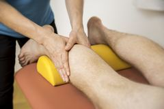 Physiotherapy calf massage Royalty Free Stock Photos