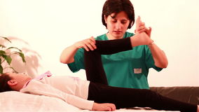 Physiotherapy for children at legs Stock Photo