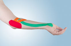Physiotherapy for elbow pain, aches and tension Stock Photo