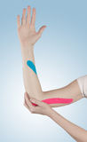 Physiotherapy for elbow pain, aches and tension Stock Photos