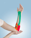 Physiotherapy for elbow pain, aches and tension. Royalty Free Stock Photos