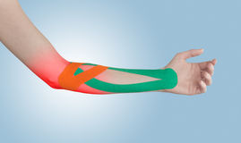 Physiotherapy for elbow pain, aches and tension. Stock Image