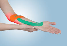 Physiotherapy for elbow pain, aches and tension. Stock Images