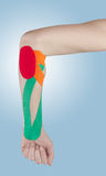 Physiotherapy for elbow pain, aches and tension. Stock Photography