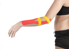 Physiotherapy for elbow pain, aches and tension. Physiotherapy treatment with therapeutic tape for elbow pain, aches and tension. It is also used for prevention stock photos