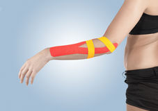 Physiotherapy for elbow pain, aches and tension. Physiotherapy treatment with therapeutic tape for elbow pain, aches and tension. It is also used for prevention royalty free stock photography