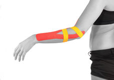 Physiotherapy for elbow pain, aches and tension. Physiotherapy treatment with therapeutic tape for elbow pain, aches and tension. It is also used for prevention royalty free stock images